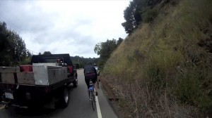 Truck passing cyclist small